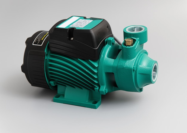 Vortex self-priming pump, top-side view, on a light gray background
