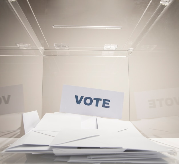 Vote word on a white card and stack of envelopes