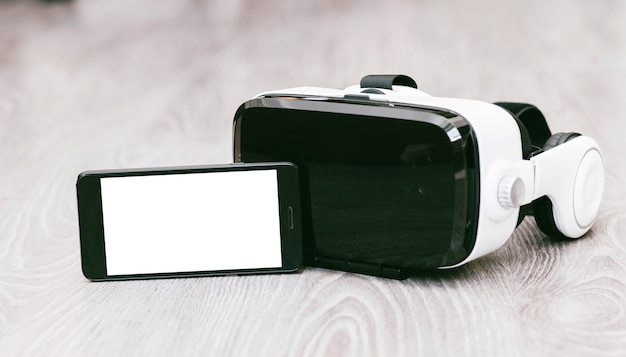 Vr glasses or virtual reality headset helmet with phone wood surface