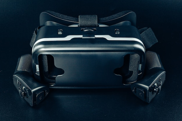 Vr virtual reality glasses on a black table.