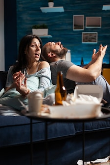 Vulnerable couple struggling with mental problems health going through a major emotional break up period. victims of stress screaming frustration at each other getting aggressive