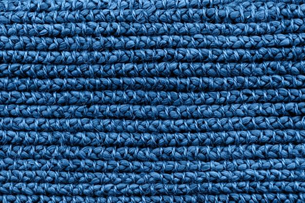 素朴な自然wテクスチャは、古典的な青のモノクロカラーのトーン。編組パターンマクロ撮影。