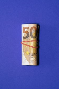 Wad of 50 euro bills. saving money concept