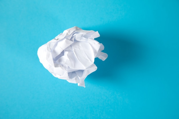Wad of paper on blue surface