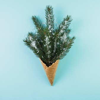 Wafer cup with fir twig and ornament snow