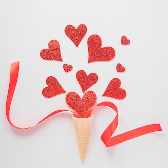 Wafer cup with ornament hearts and ribbon