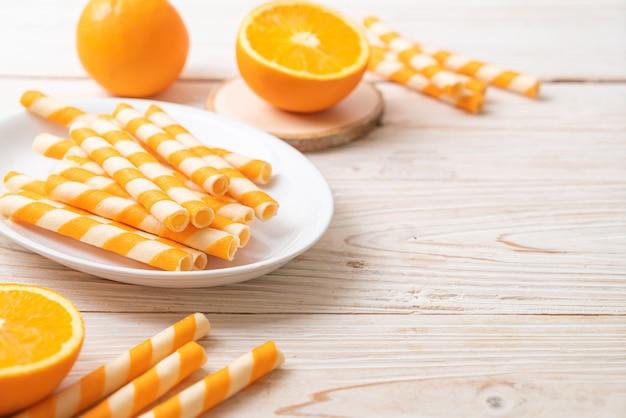 Wafer roll with orange cream flavor