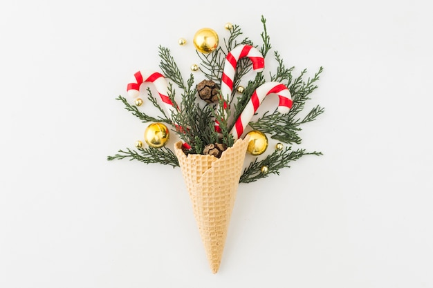 Waffle cone with branches and baubles