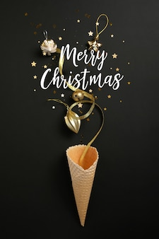 Waffle cone with christmas elements and lettering merry christmas