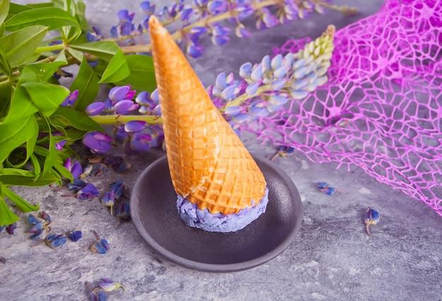Waffle cone with purple lilac ice cream