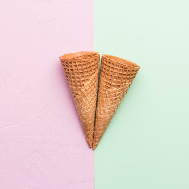 Waffle cones on different color background