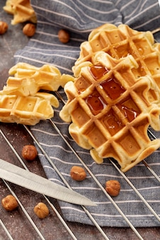 Waffle covered in honey with hazelnuts