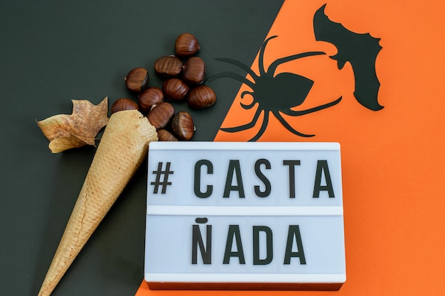 Waffle ice cream cone with chestnuts spider and bat animal  text castañada.