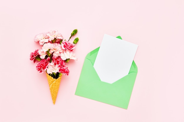 Waffle ice cream cone with colorful carnation flowers