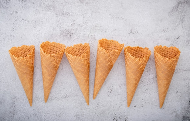 Waffle ice cream cones on a concrete table