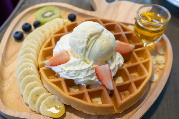 Waffle ice cream vanilla topping with banana and strawberry