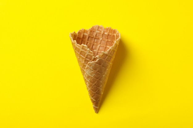 Waffle for ice cream on yellow surface