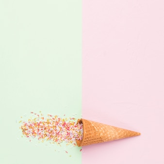Waffle style sugar cone and rainbow sprinkles