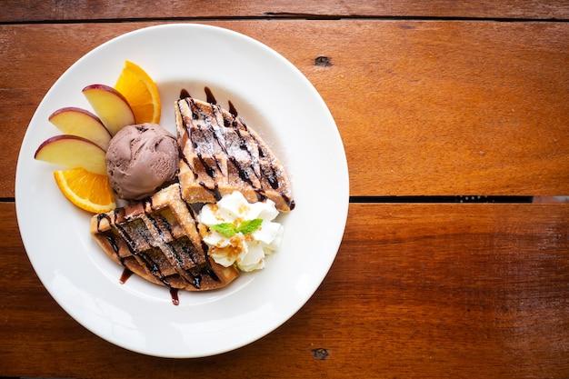 Waffle with chocolate ice cream and fresh fruit