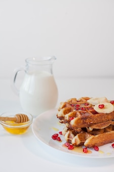 Waffle with milk and honey
