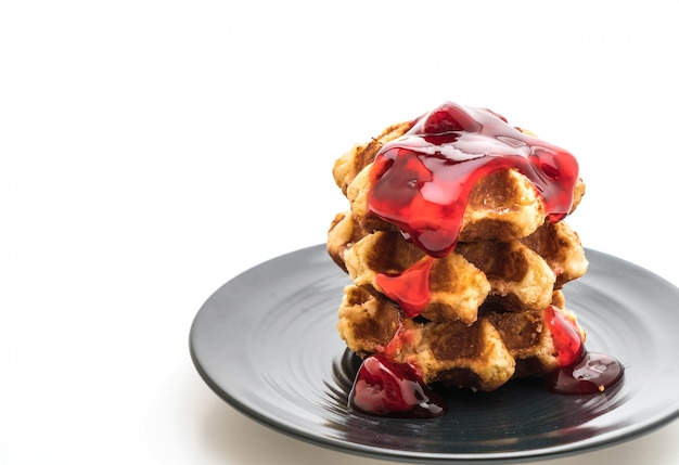 Waffle with strawberry sauce