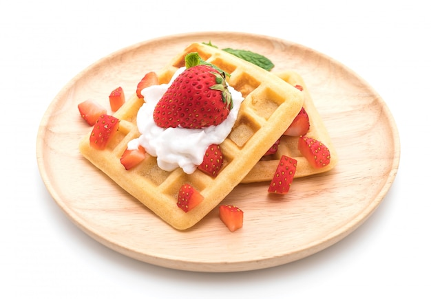 Waffle with strawberry on white