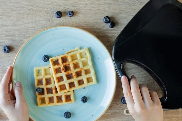 Waffles being baked in the waffle maker. savory waffles. breakfast concept