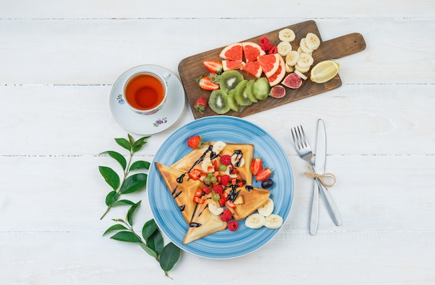 Waffles and fruits in blue plate with fruits