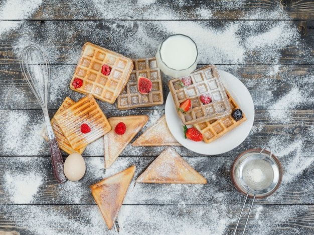 Waffles with berries and toasts
