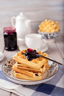 Waffles with blackcurrant jam