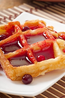 Waffles with cranberry syrup