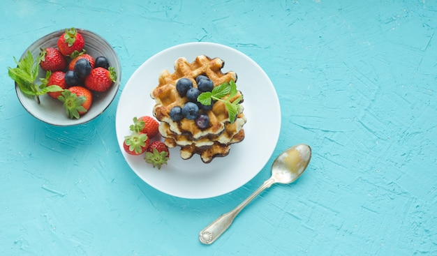 Waffles with fruits in white plate