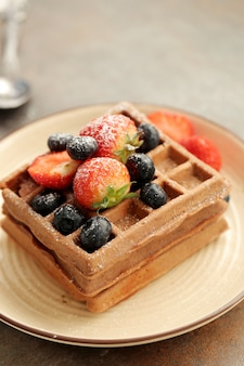 Waffles with strawberry and blueberry
