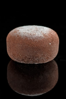 Wagashi mochi with truffle with cherry on black background. copy space, selective focus, asian menu, cuisine.