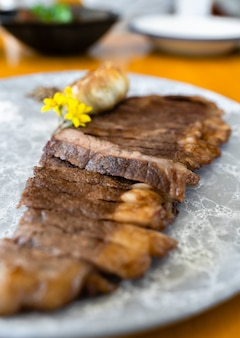 Wagyu beef well done steak in a plate
