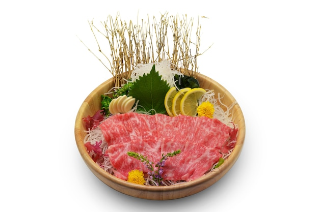 Wagyu set on ice in brown wooden bowl and on white background