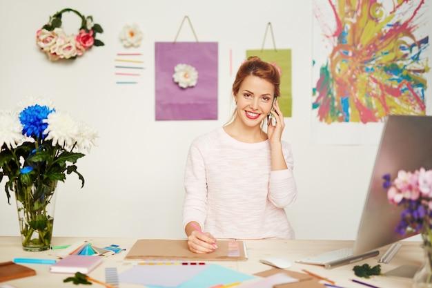 Waist-up portrait of pretty fashion designer