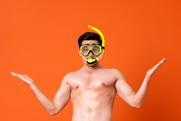 Waist up portrait of a young shirtless caucaisan man wearing snorkel