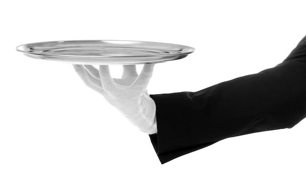 Рука официанта с подносом на белом