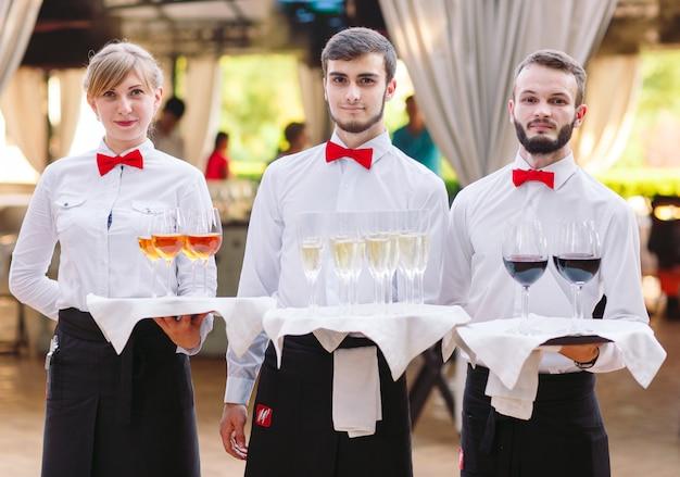 The waiter keeps serving alcoholic beverages.