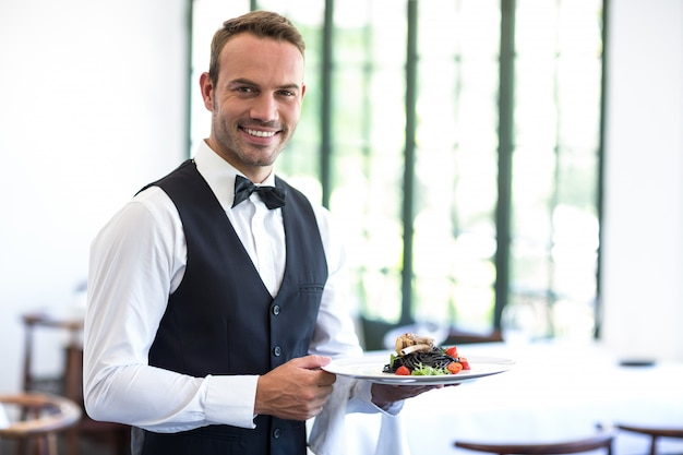 Waiter showing a dish