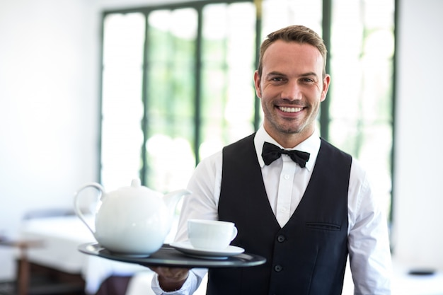 Waiter smiling at camera