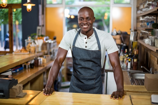 Waiter standing at counter