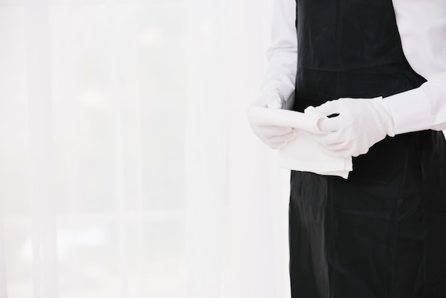 Waiter in uniform holding cloth