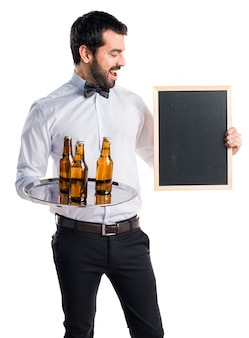Waiter with beer bottles on the tray holding an empty placard