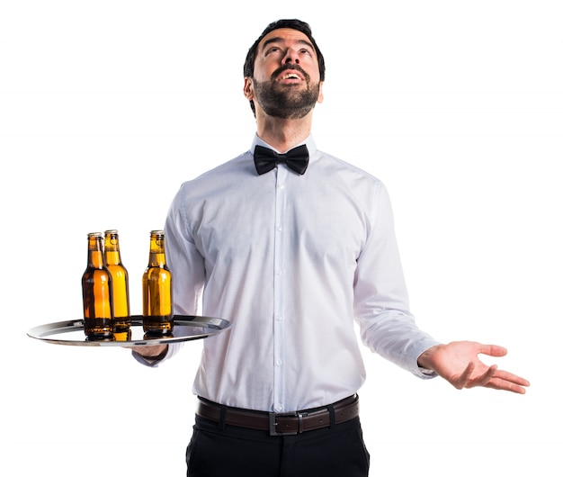 Waiter with beer bottles on the tray pleading