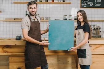 Waiters presenting chalkboard