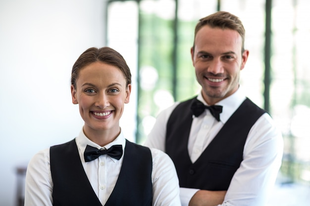 Waiting staff smiling at camera