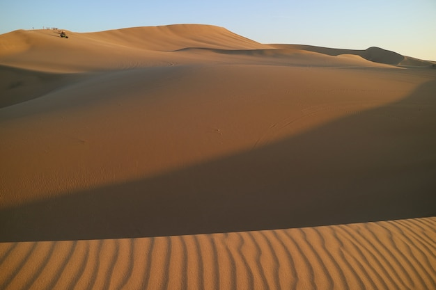 Waiting for sunset on the immense sand dune of huacachina