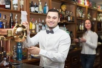 Waitress and barmen working